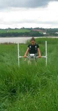 One of Wessex Archaeology's geophysicists using a gradiometer to detect buried vessels