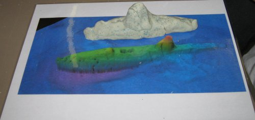 The geophysical image is of the HMS A1, a submarine, which has been modelled by Year Four pupils.